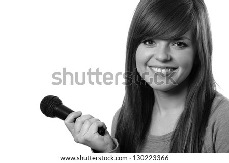 Singer - This is a black and white shot of an attractive young lady smiling and holding a microphone. Shot on and isolated white background.