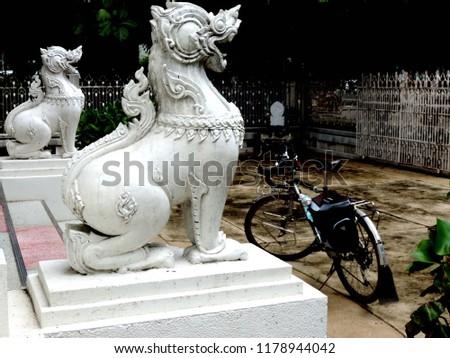 Singha the porter and touring bike,culture city tour,Ubonratchatani,Thailand #1178944042