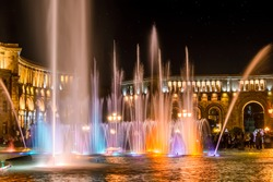 Singing and Dancing Fountains in Republic Square in Yerevan. Night city lights show.
