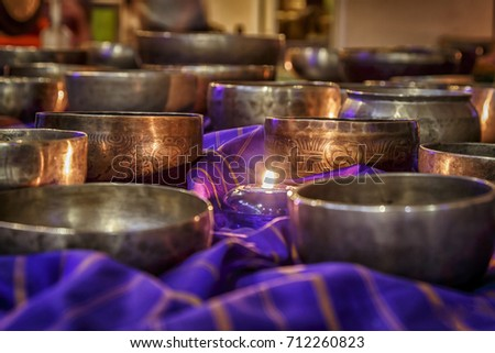 singing bowls lit by candlelight #712260823