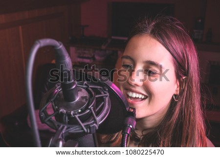 Singing girl singing with a microphone. Close-up of a woman singing #1080225470