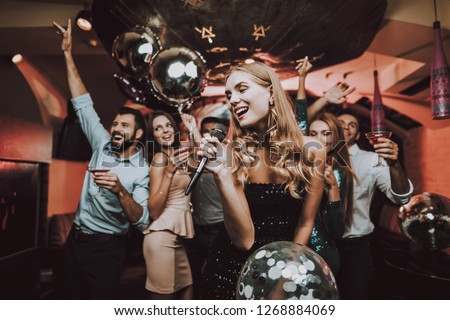 Singing Songs. Black Dress. Have Fun. Celebration. Background. Trendy Nightclub. Cheerful. Smiling Girl. Singing Songs. Handsome Men. Beautiful Girls. Friends at Karaoke Club. Karaoke Club.