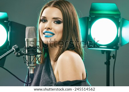 Singing star. Woman singer portrait. Sound studio.