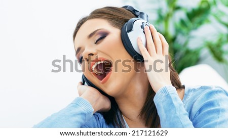 Singing woman portrait with headphones.