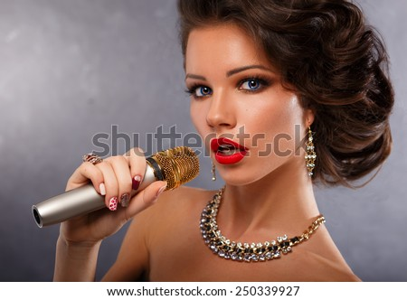 Singing Woman with Microphone.Glamour Singer Girl Portrait. Vintage Style. Karaoke Song