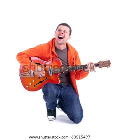 singing young man playing on electric guitar