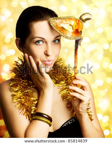 single beautiful woman with carnival mask - stock photo