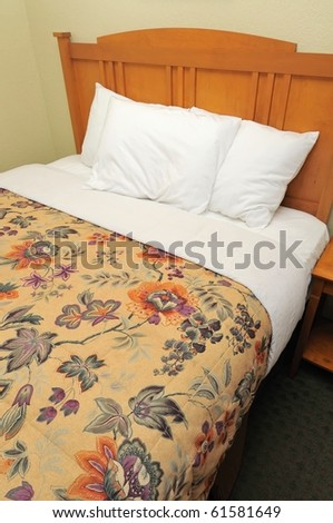Single bed in hotel room for generic concepts. Suitable for concepts such as budget travel, tourism, vacation and holiday, and relaxation.
