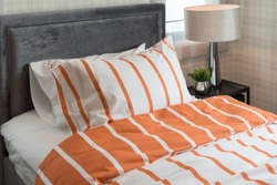 single bed in modern bedroom with orange and white color tone, interior design concept