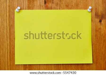 Single blank sheet attached to a wooden wall