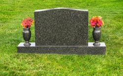 Single blank tombstone with flowers