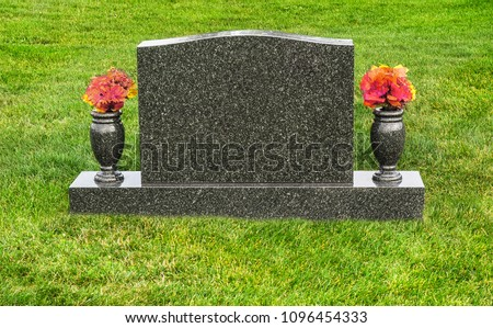 Single blank tombstone with flowers ストックフォト ©
