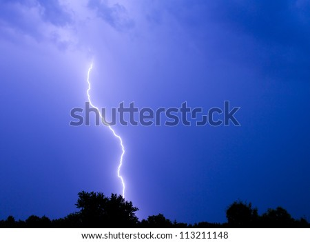 Single bolt of lightning in a thunderstorm.
