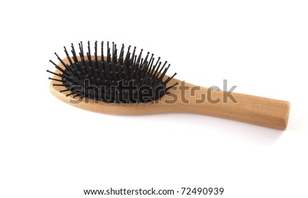 Single brown hair brush on a white background.