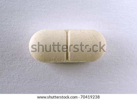 Single Brown Oval Tablet On White Background Stock Photo 70419238