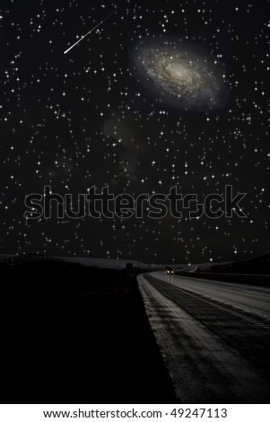 Single car travels on dark road under stars