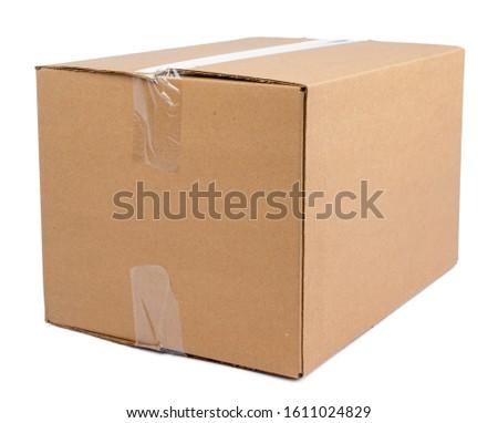 Single carton moving box isolated on white background
