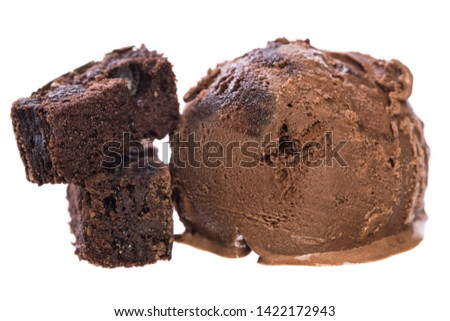 Single chocolate - brownie ice cream ball with brownies isolated on white background front view  real edible icecream, no artificial ingredients used! #1422172943