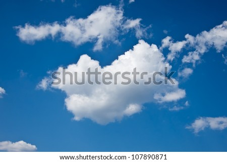 single cloud in blue sky