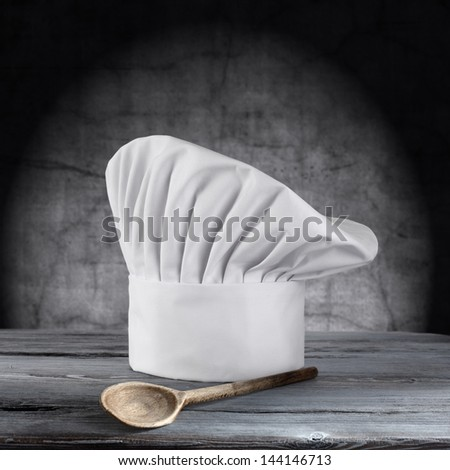 single cook cap and one wooden spoon