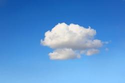 Single cumulus cloud on a blue sky