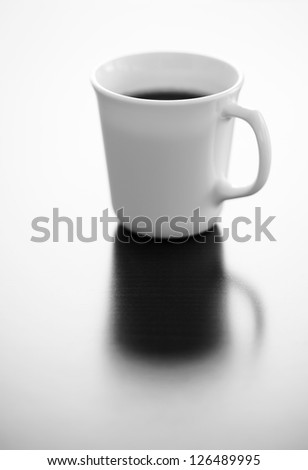 Single cup of black coffee