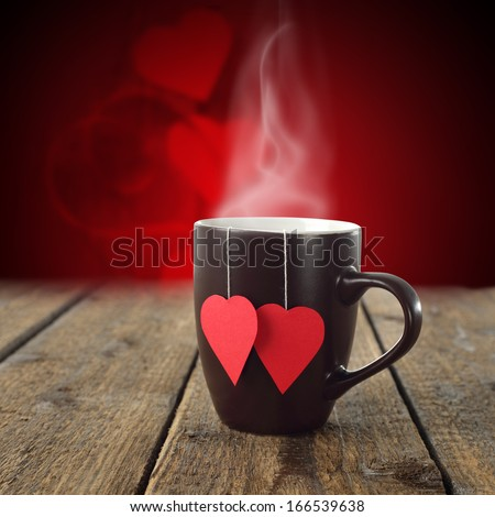 single cup of love on dark table