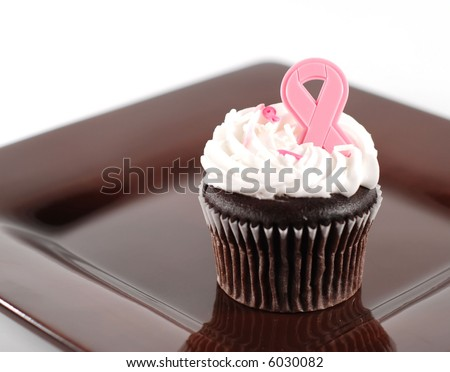 single cupcake with pink ribbon decoration for breast cancer month
