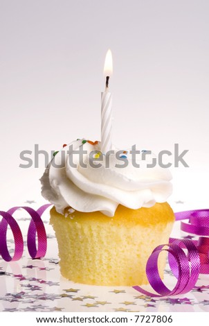 Single cupcake with White Candle