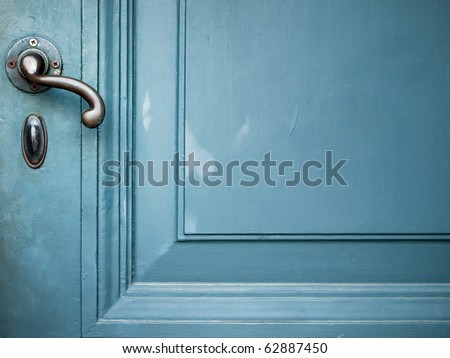 Single Door handle on old door painted with blue