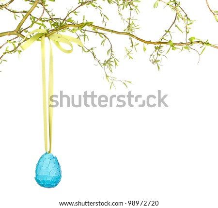 Single Easter egg hanging from branch, isolated on white