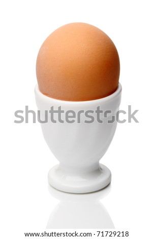 Single egg in cup isolated on a white background
