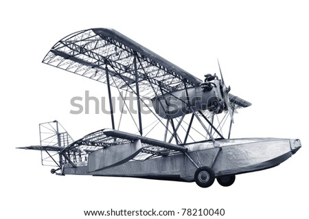 Single engine vintage airplane with some of its coverings stripped off showing skeletal frameworks isolated in white background.