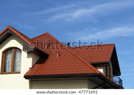 Single-family building on the background of blue sky
