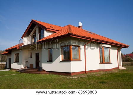 Single family house in white color against blue sky
