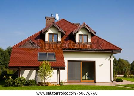 Single family white house over blue sky