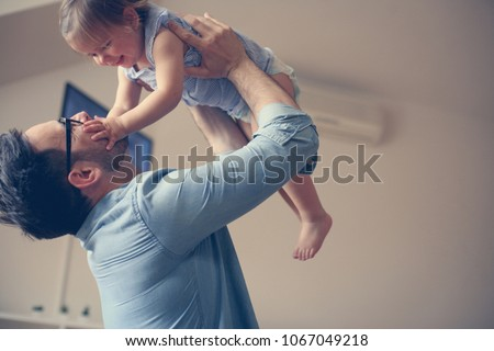 Single father with his baby girl.