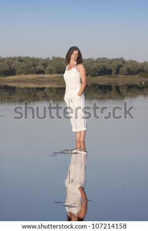 Single female standing at shoal