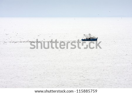 Single fishing boat during taking nets.