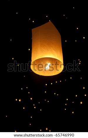 Single Floating Lantern during Firework Festival in Thailand