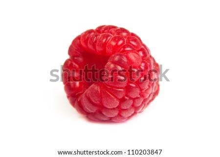 Single fresh sweet raspberry. Isolated over white background. Close up macro shot. Image was professionally retouched