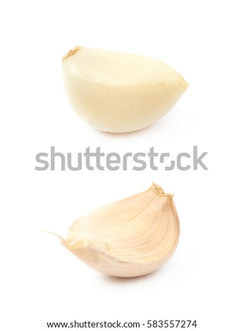 Single garlic clove isolated over the white background, set of two different foreshortenings