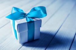single gift box on wood table