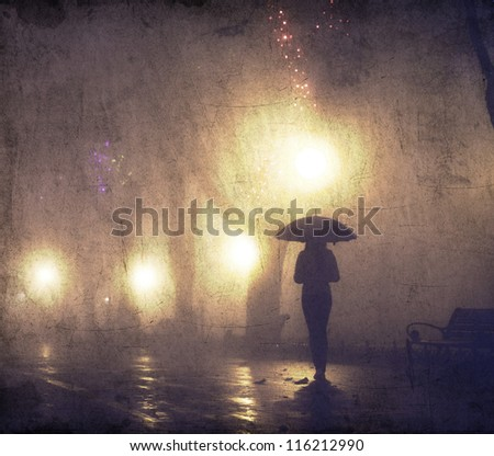Single girl with umbrella at night alley. Photo with noise. - stock photo