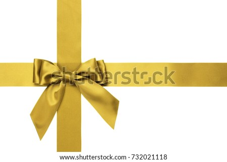 Single golden bow with tails on the side with cross wide silk ribbons on white background