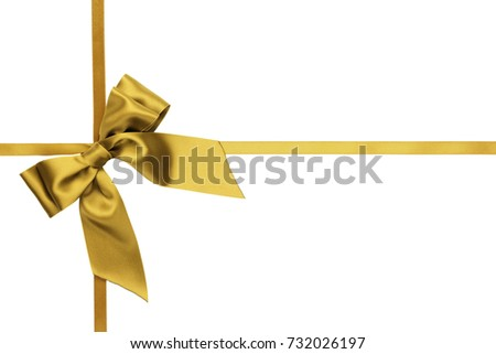 Single golden bow with tails on the side with crossed narrow ribbons on white background