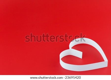 Single heart, on red background. Focus on center of heart.