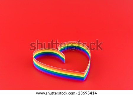 Single  heart, paint  of a six-colour gay flag on red background.