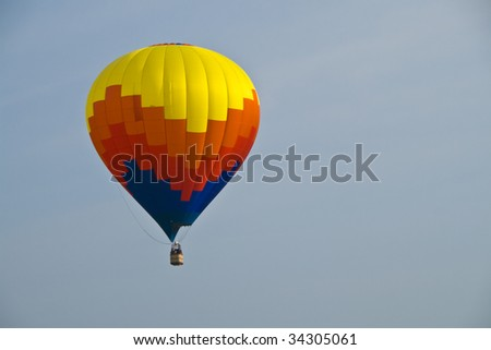 Single hot air balloon in flight landscape mode