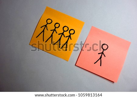 Single human figure behind a group, abstract loneliness concept #1059813164